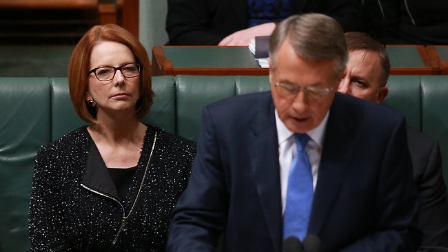 Prime Minister Julia Gillard looks on as Wayne Swan speaks at parliament.