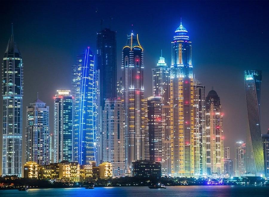 Dubai skyscrapers night lights illuminated